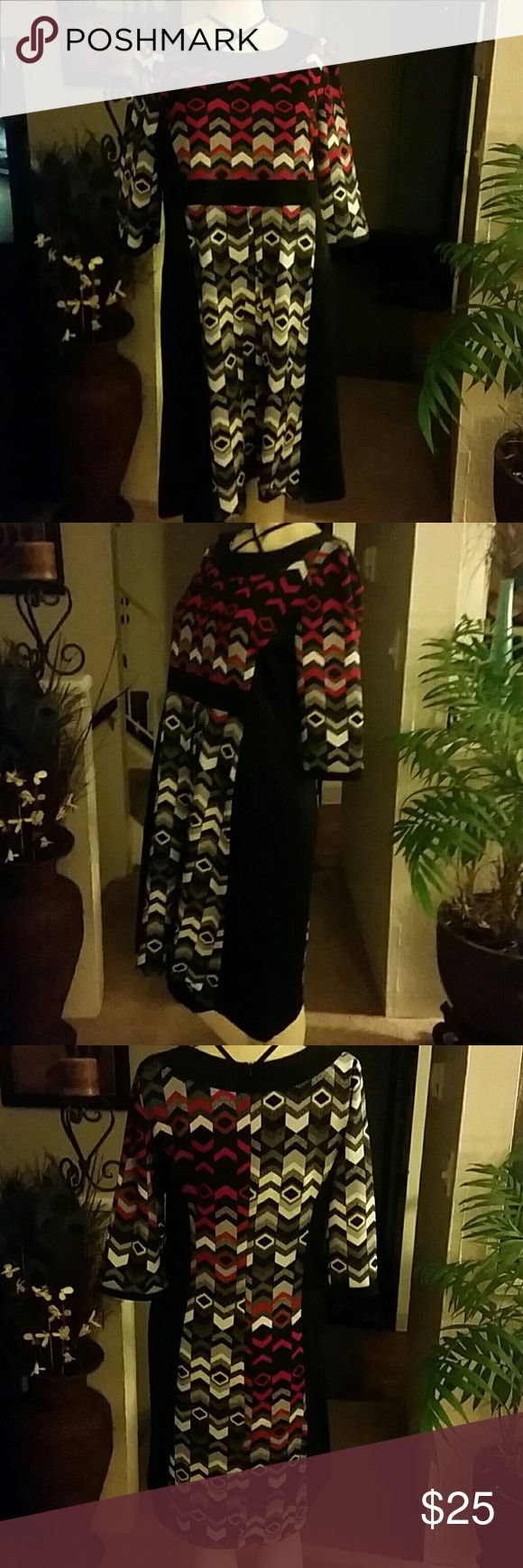 Beautiful Dress. Retro design dress colorful. 95% Polyester and 5 Spandex. In excellent condition. Dress size is 52. Dress was made in Greece. La Qualite Dresses