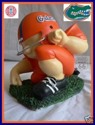 FLORIDA GATORS FOOTBALL PLAYER COLLEGE PIGGYCOIN BANK ** Learn more by visiting the image link.Note:It is affiliate link to Amazon.
