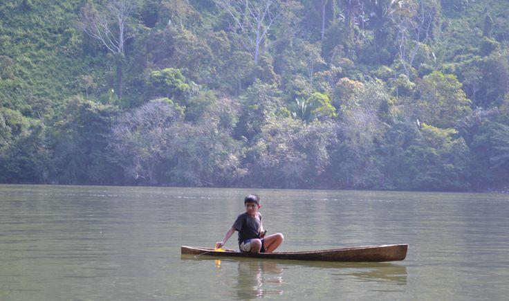 Boy in canoe, Rio Dulce., Guatemala.
