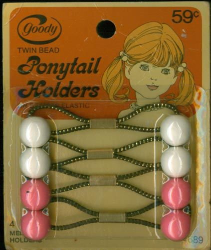 Goody Ponytails! mine were always lopsided! AO