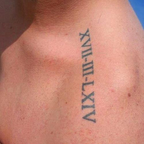 Little clavicle tattoo of a date in roman numerals.
