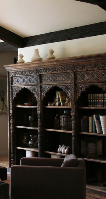 Textured bookshelves with interesting tops.  Could add pressed metal to plain shelves?