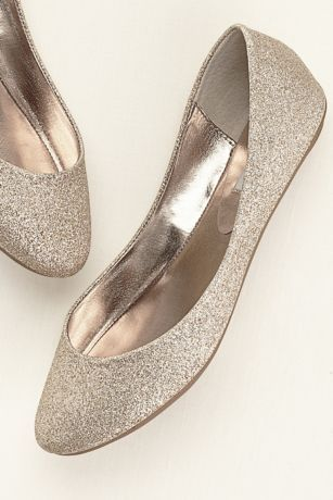 Slip into style and comfort with these on-trend glitter ballet flats!   Features flexible rubber sole.  Fully lined.  Imported.