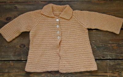 Vintage Knitted Cardigan 10.00 Lovely piece from our range of vintage clothes for kids.  Great condition vintage knitted cardigan in a lovely peach colour  Age 2 years +  Customise with some of our kids accessories