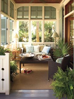 Get This Look    Shutters: Classic Line by New Horizon Shutters; Exterior Shutter and Porch Floor Paint: Spanish Moss by Glidden; Wall Lanterns: Charleston Wall Lantern by The Urban Electric Company; Throw Pillows: from the Fairytale Collection by Ankasa    »  Coastal entertaining porch  See More Outdoor Rooms