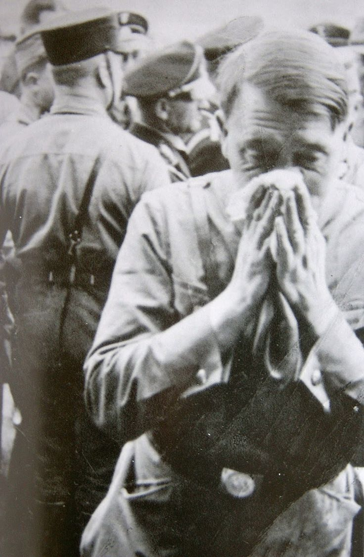A very rare, candid shot of Adolf Hitler blowing his nose