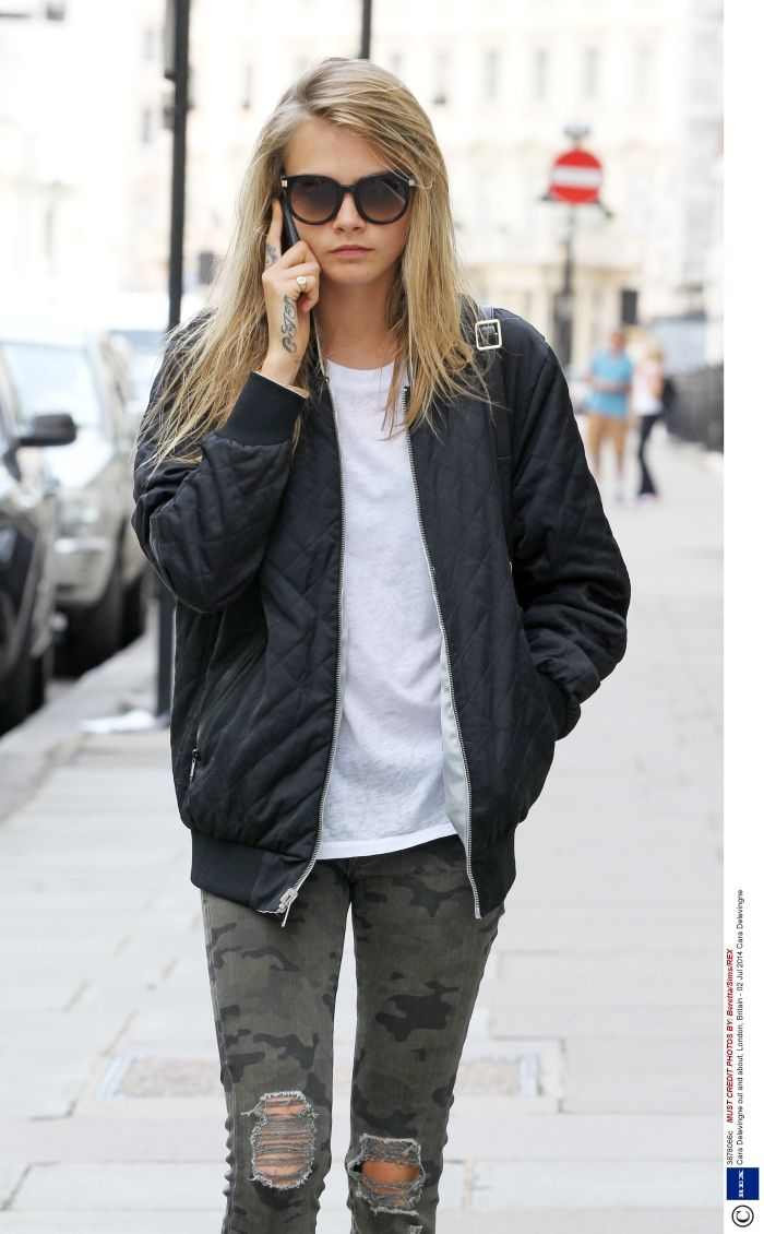 Inside-out #CaraDelevingne has been spotted in the Reversible Tour Jacket from the Marc Newson AW14 collection.
