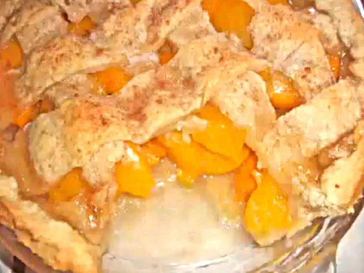 A nicely baked peach cobbler. A fine video showing how to prepare this classic recipe loaded with the peaches. It has a rich double pie like crust instead of the typical biscuit