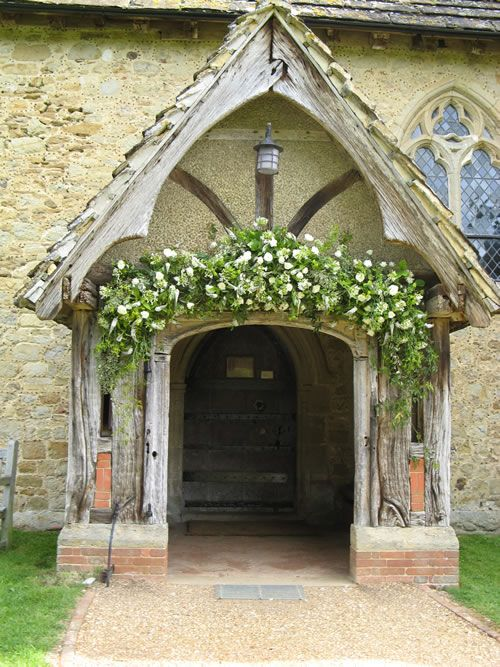green and white flower arrangement for outside of the church