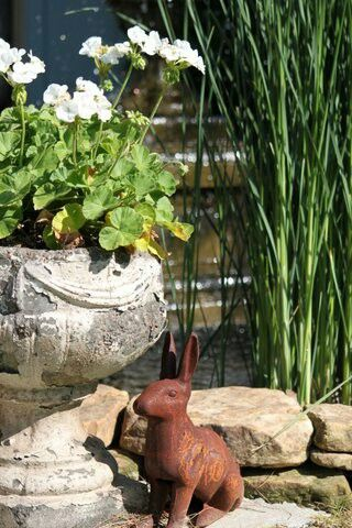 I love adding rusty and chippy pieces to my garden