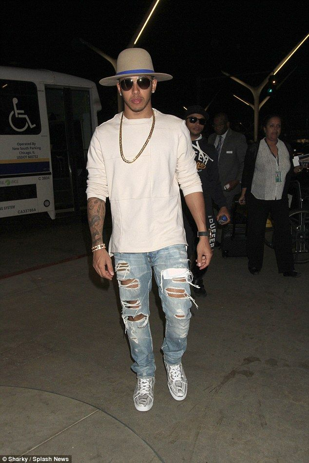 Safari swag: Lewis Hamilton wore an oversized hat as he arrived at LAX on Tuesday evening ...