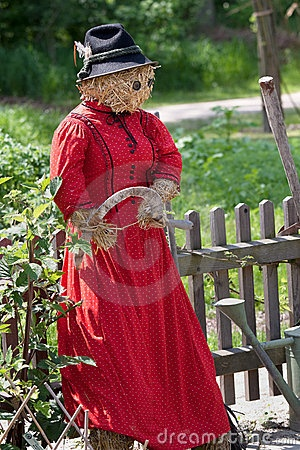 Scarecrow lady in red.