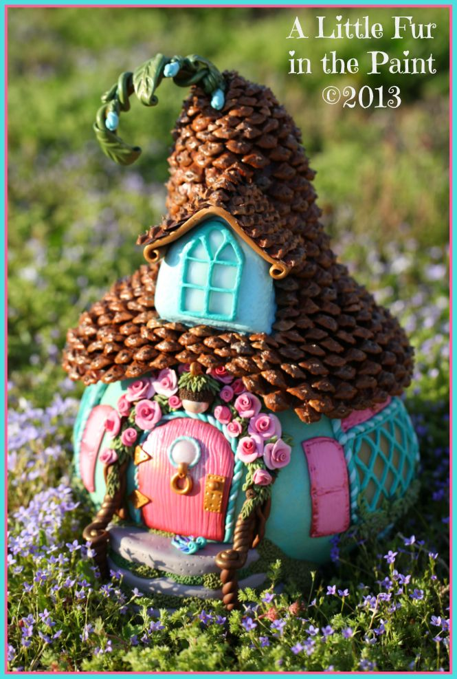 Absolutely adorable fairy houses by Anne, shown on her blog, A Little Fur in the Paint.