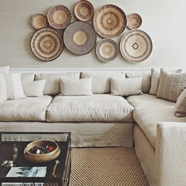 I love how @susana.chango & her team created this cozy living room area by hanging unique baskets of different sizes on the wall! #inspiration #loveit