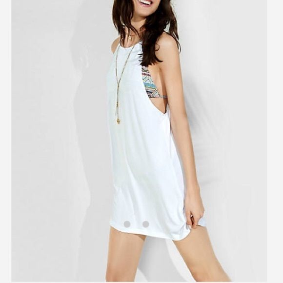 Express trapeze dress Express Hi-Lo Shirttail Trapeze Dress size xs new with tags. So cute for a summer beach coverup! Express Dresses