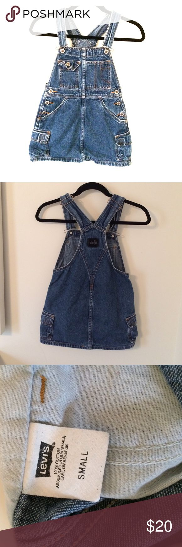 Levi's Jean Jumper/Skirted Overalls This is a sturdy vintage Levi's piece with orange stitching and six pockets. The straps are adjustable and are in their smallest setting in the photos. Levi's Dresses Casual
