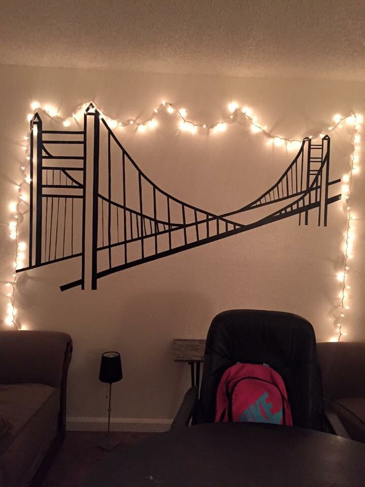I had this huge wall in my apartment and wanted to do something with it so I used electric tape and did this wonderful master piece of the Golden Gate Bridge❤️ By the way this was don't free hand, using no stencil.