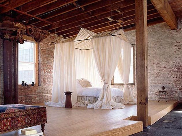 Romantic bedroom with four poster bed