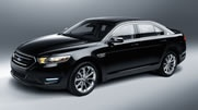 2013 Taurus Limited in Tuxedo Black Metallic with available 20-inch polished aluminum wheels and rear spoiler
