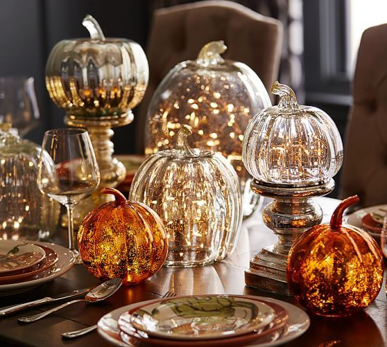 love the string lights inside these recycled glass pumpkin candle cloches from pottery barn - Pottery Barn Halloween Decorations