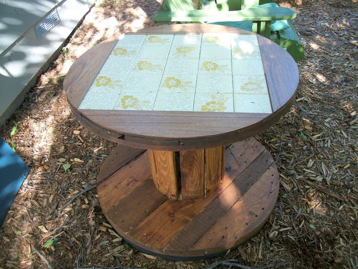 https://flic.kr/p/W1UBJG | New Table. | This spool was found in our son-in-law's burn pile, the tile came from the local landfill. So, my 'Handy Kinda' Guy' made a table to go in our sitting area under the birch tree. With a plug on the wall right there a good place for the morning coffee maker.