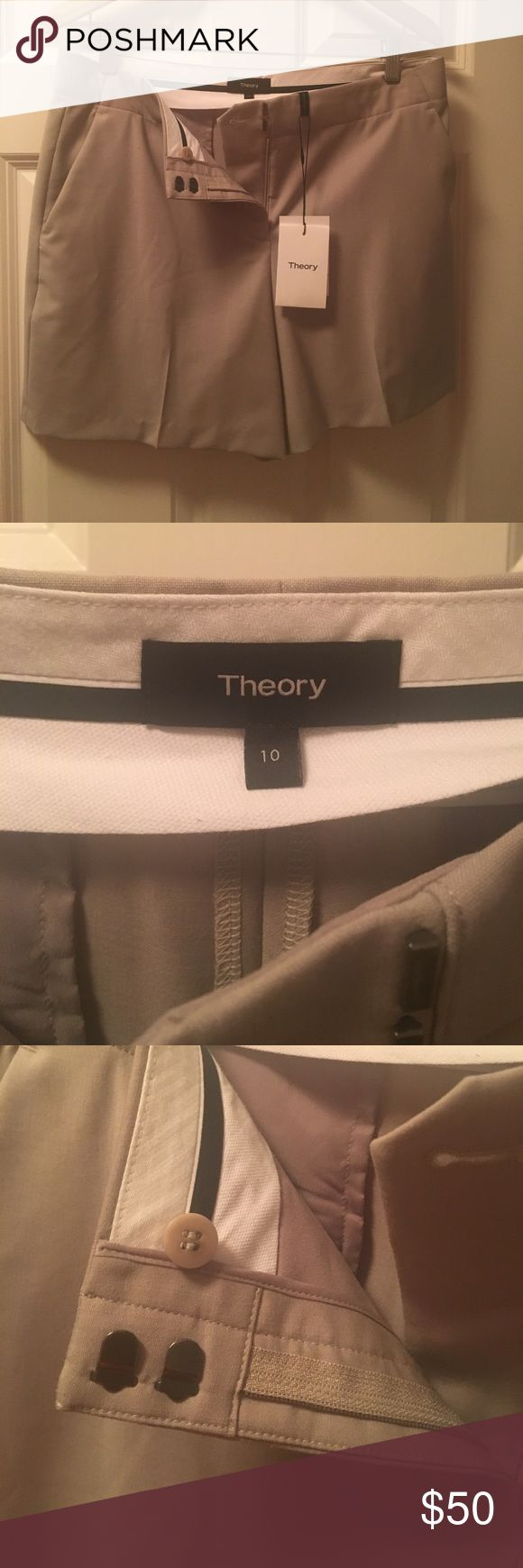 """Theory khaki dress shorts brand new with tags's, Theory Masibeth """"gray khakl tailored shorts with 4 inch inseam. Suiting material suitable for dressy look or golf. /Pockets at the hips, and two button pocket on the back. Size 10. Theory Shorts"""