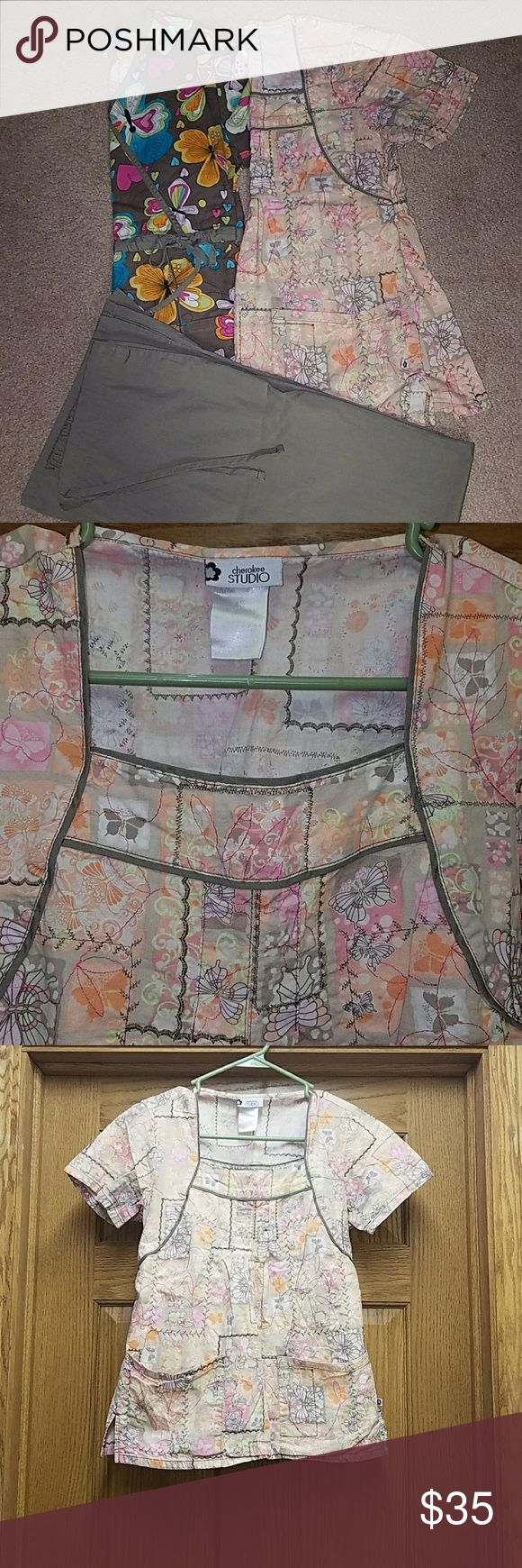 Scrub sets Excellent condition! Absolutely adorable scrub tops with one pair of pants that match both! Beautiful detail on lighter colored top by Cherokee studio (my favorite scrub top)! Very feminine, unique tops! All size XS. Cherokee Other
