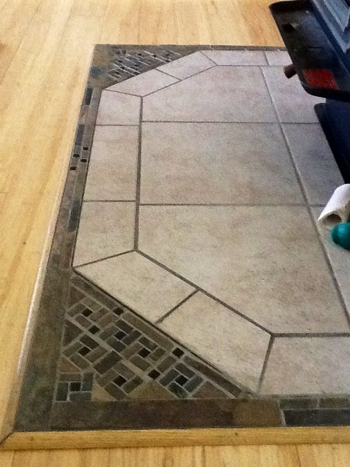 Tile work around the hearth of the wood-burning stove.