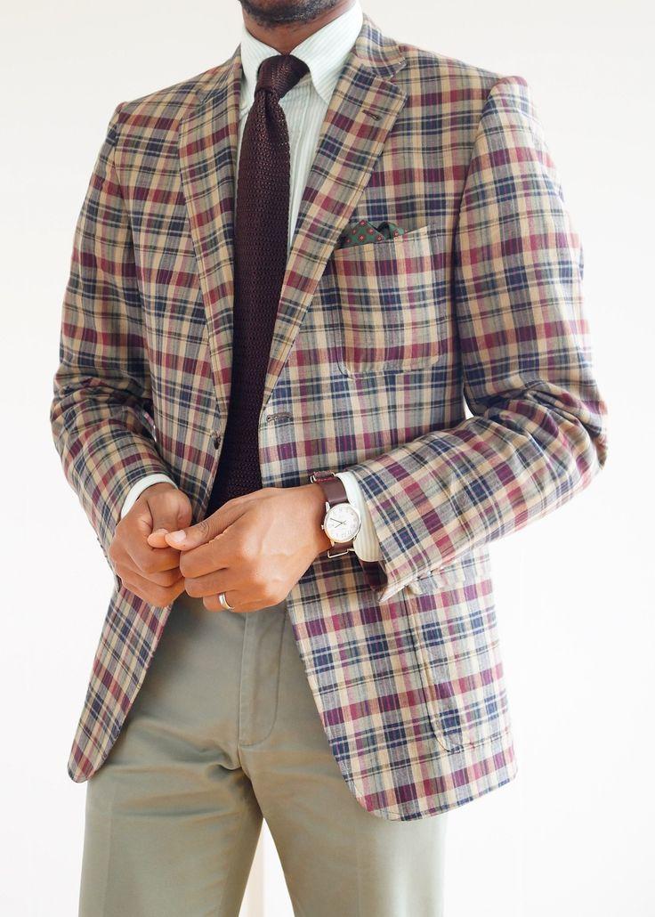 Plaid jacket, white shirt with light green dress stripes, brown knit tie, olive khakis