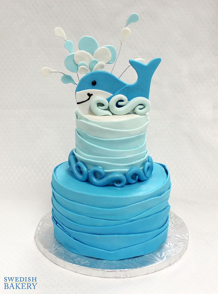 Whale Waves | Two tiered, fondant children's party cake with fondant waves and happy whale topper.