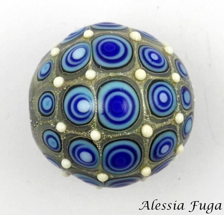 Lampwork glass bead in turquoise and blue with small ivory dots di alessiafuga su Etsy