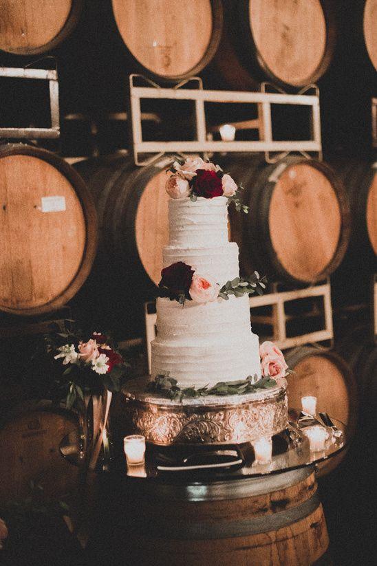 flower topped wedding cake @weddingchicks
