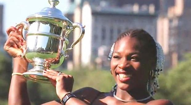 Serena Williams posing with her first Major trophy, the U.S. Open trophy, at age 17 at the 1999 U.S. Open. She defeated then World #1 Martina Hingis.
