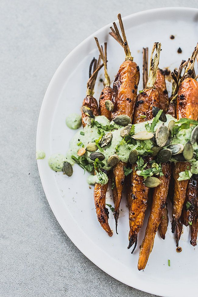 Roasted Carrot with Yogurt Sauce — a superflavorful and healthy side, the yogurt sauce is flavored with black garlic (sub roasted garlic if you can't find black garlic), mint, and cilantro, via @topwithcinnamon