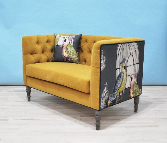 Handmade Loveseat tufted sofa upholstered with cotton printed fabrics. Mustard color fabrics on the seating area and bird printed fabrics on...