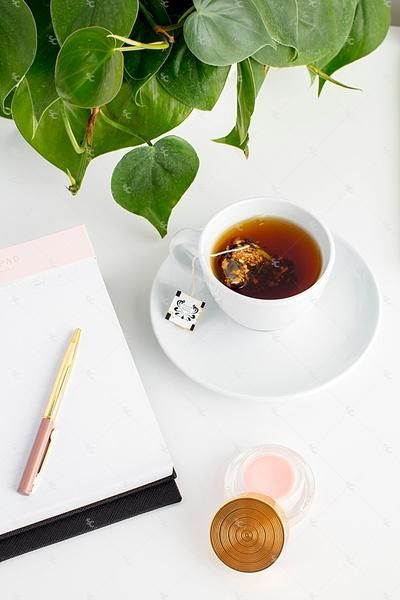 Styled stock photography images featuring blush pink styled office desktop flatlays for creative businesses. Images with pink desk accessories and greenery.
