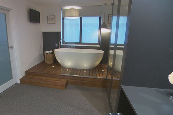 love this platform up for the bath and that it is wood. also love the bath under the window. and lights in the wood.