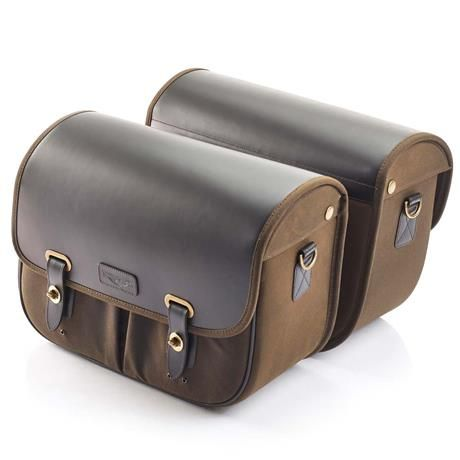 Triumph Street Twin Motorcycle Luggage Accessories | The Triumph Olive Waxed Cotton Saddlebags are a pair of durable, water-repellent panniers crafted from PU coated leather and olive green waxed cotton. They are sure to enhance the traditional, heritage feel of your Triumph. Featuring brushed gunmetal hardware, 27.6 liters of storage capacity (13.8 liters per bag), and come complete with mounting harness. They can be mounted individually (to the left or right-hand side) or as a pair.