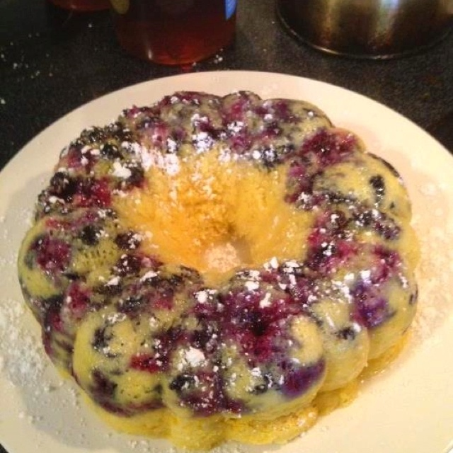 Fresh Blueberry lemon Bundt cake!! Super easy in the stoneware fluted pan from Pampered Chef! Lemon Cake mix made according to the box, dump into the stone, add blueberries and microwave for 12 minutes!!  Flip out and enjoy!!! Check out Facebook.com/dinnerrecipes for more 12 minute cake ideas!!!!