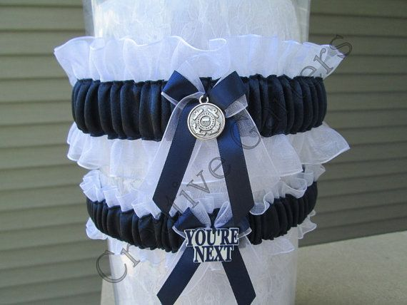 Coast Guard garter set with silver colored Coast Guard charm and a You're Next charm.