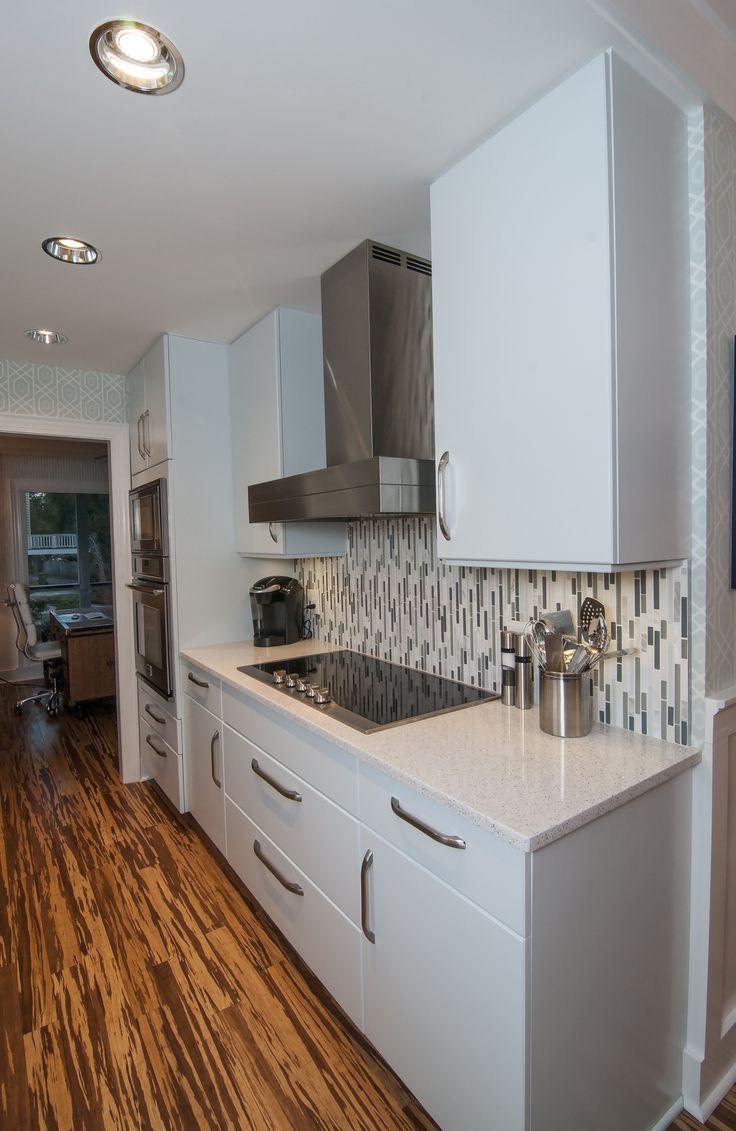 Cabico cabinetry, Bliss tile back splash, and Whitney Cambria Quartz countertops. backsplash