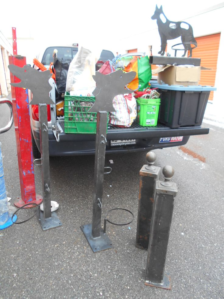 Lots of industrial bike racks and bike hitching posts from our last locker.  I think these would make great dog tie ups as well.
