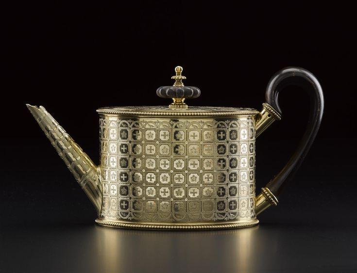 Silver-gilt teapot with flat hinged lid with ebonised wood knob, engraved with cinquefoils and crosses as heraldic devices of William Beckford of Fonthill Abbey: English, London, by Peter Podio, 1802 - 1803
