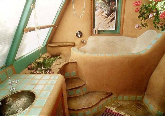 awesome cob bathroom! LOVE the turquoise tile accent and the deep tub :)