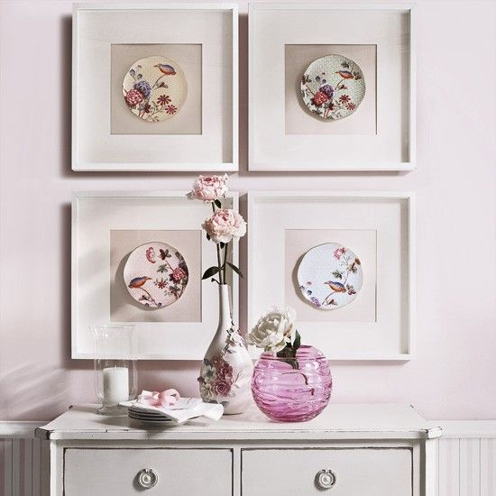 Wall display with framed plates.