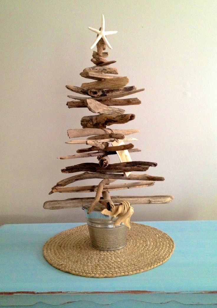 Coastal Collection Driftwood Tree  Standing 2' tall, these driftwood trees are completely hand-crafted from Jersey Shore driftwood and beach sand. Trees sit in a galvanized sand pail with a burlap tie on the bail and are adorned with a gift tags for easy gift-giving. A white starfish commans attention at the top of the tree.  https://www.etsy.com/listing/158909274/jersey-shore-driftwood-tree-by-the?ref=shop_home_active