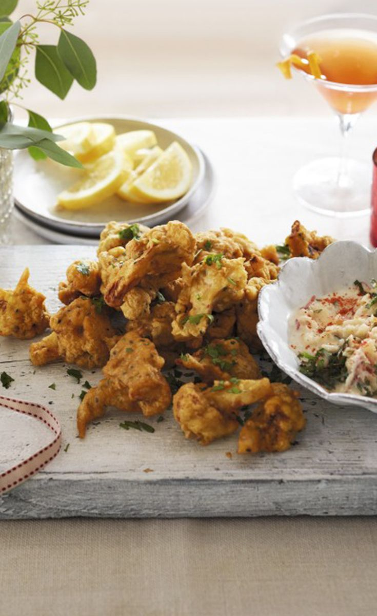 Keep your guests' hunger at bay on Christmas Day with the Waitrose recipe for cauliflower bhajis with raita. This recipe also works brilliantly with other vegetables.