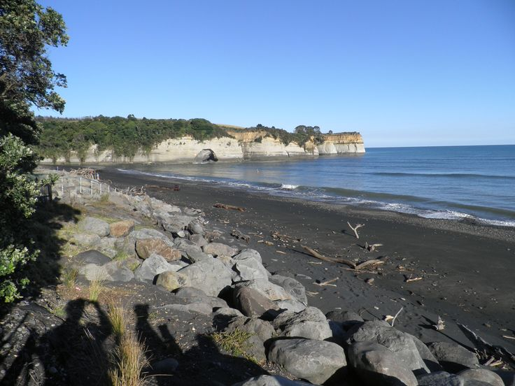Urenui Beach. Note the erosion to the cliff at the mouth of the Urenui River.
