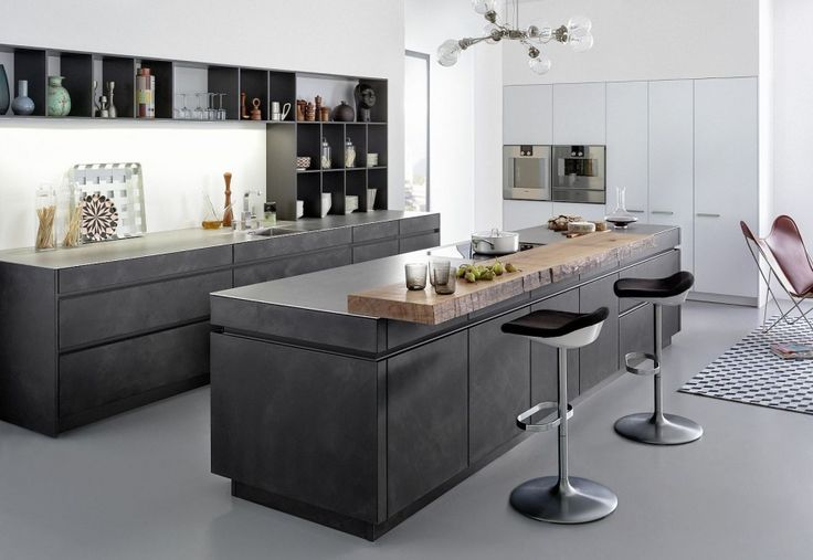 modern kitchen in graphite. concrete floor.