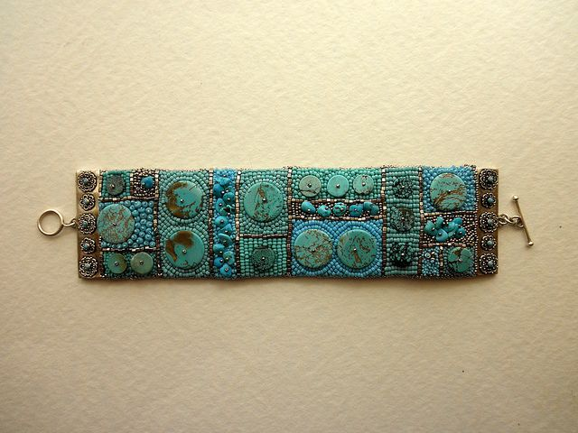 WoT 1 by morwynskya, via Flickr.  It has several types of turquoise disks and nuggets, and a sterling silver/turquoise connector.